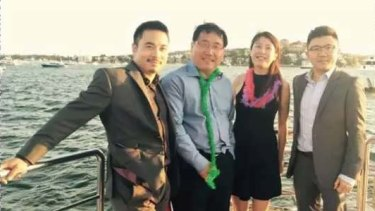 Simon Zhou (left) with former Chinese consul-general in Sydney, Li Huaxin (second from left) and two others.