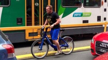 Arnold Schwarzenegger riding on Elizabeth Street on Monday.