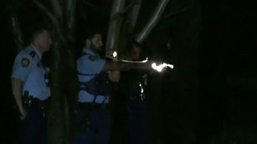 Police kept their guns trained on the man as he remained in the dam.