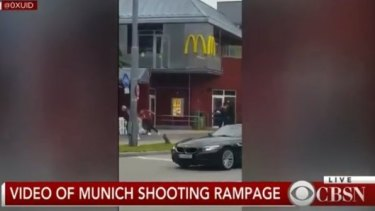 Mobile footage of a gunman outside a Munich McDonalds.