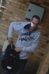 A bike-riding man with a patch allegedly caught on camera at Noble Park during a burglary.