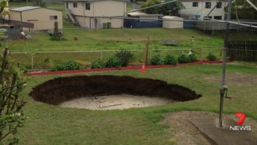 The Ipswich couple woke to this hole in their backyard.