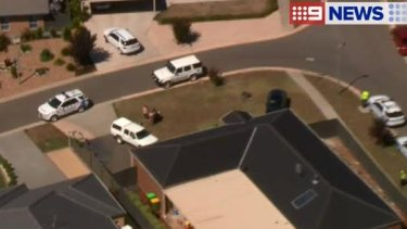 Police outside a home in Kyneton after a baby was found dead in a car.