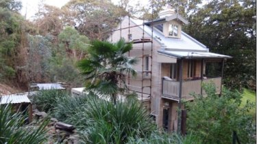 The Sheridans' Waverton cottage is surrounded by bushland.