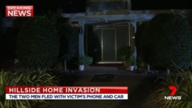 The woman's house on Tuesday night, after the violent home invasion.