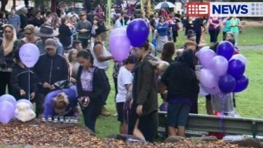 Hundreds attended a candlelight vigil for the 12-year-old, who was found dead at Pimpama.