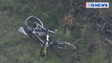 A mangled bicycle at the scene of the crash.