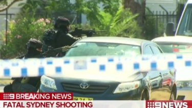 Heavily armed police outside Inline National Signage in Ingleburn.