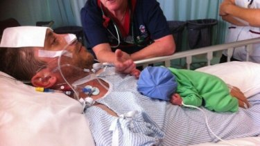 Ben was paralysed before his new baby son, James, was a fortnight old.