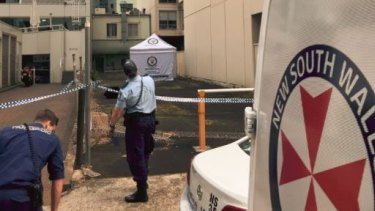 A tent covered the body of a woman found dead in the Chatswood alley.