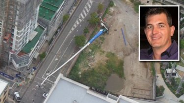 The crane fell at a Newstead construction site while Chris and Brendan Powell were taking professional photographs.