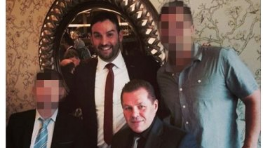 """Liverpool councillor Peter Ristevski is accused of blackening the party's name, including by associating with a convicted drug dealer nicknamed """"The Falcon"""" whose real name is Tony Atanasovski, seated."""