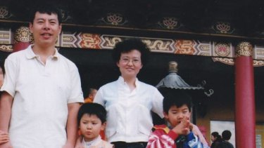 "Min ""Norman"" Lin, 45,  with his wife Yun Li ""Lily"" Lin, 43,and their two sons Lins' Henry and Terry"