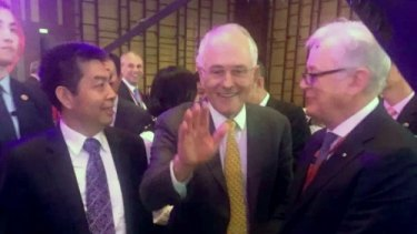 Landbridge head Ye Cheng, Prime Minister Malcolm Turnbull and then trade envoy Andrew Robb in Beijing in April 2016. Three months later, Mr Robb was on Landbridge's payroll.