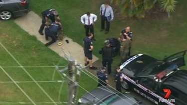 Police have charged a man who was running with a replica gun.