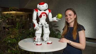 Nicole Robinson with one of the NAO robots.
