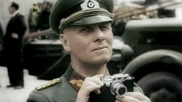 In this colourised screen grab from the documentary series The World at War, German Field marshal Erwin Rommel with his Leica III rangefinder camera.