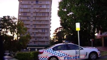 Police outside an Auchenflower apartment building where an 11-year-old girl was found dead.