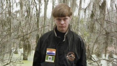 Alleged Charleston gunman ... A picture on Dylann Roof's Facebook page showed the 21-year-old wearing a black jacket with patches of the apartheid-era South African flag and the flag of white-ruled Rhodesia, which is now part of Zimbabwe.