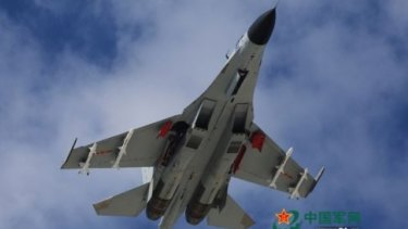 A People's Liberation Army J-11 fighter on exercises over the South China Sea.