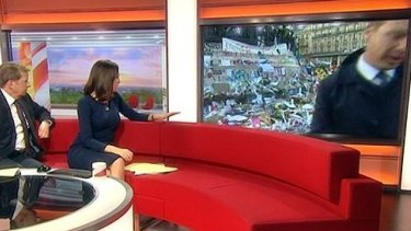BBC Reporter Graham Satchell goes off screen during the live cross