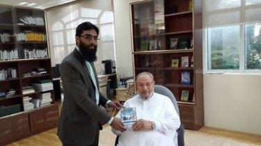 Waseem Razvi (left) with Sheikh Yusuf al-Qaradawi.