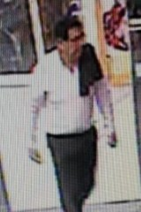 Police are seeking a man who allegedly stole an elderly woman's handbag from hospital.