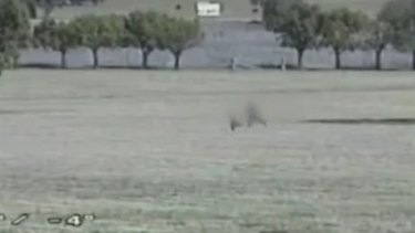 The two men could be seen running across the field next to the prison.