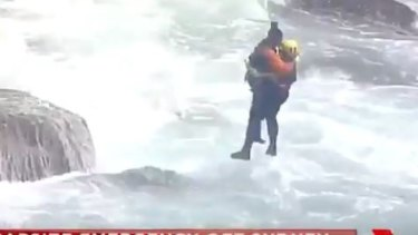One man was winched to the top of the cliff where he was treated for serious lacerations to his fingers.