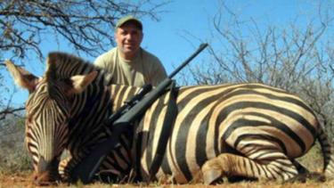 Trophy: Hristo Stoichkov poses with a dead zebra.