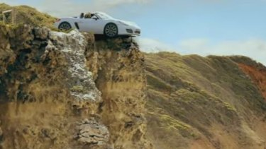 Ultra Tune Australia ad depicts two women in a car which goes off the cliff after being put in the wrong gear.
