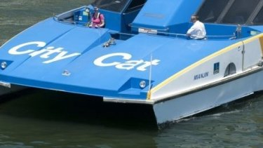 A CityCat ferry has crashed into two rowers on the Brisbane River.