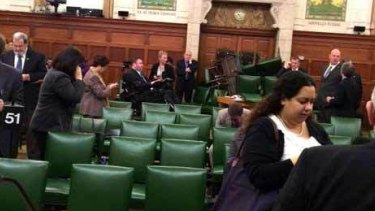 MPs block the door with chairs during a caucus meeting on Parliament Hill in Ottawa.