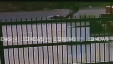 CCTV footage shows the woman being dragged along the road by the man.