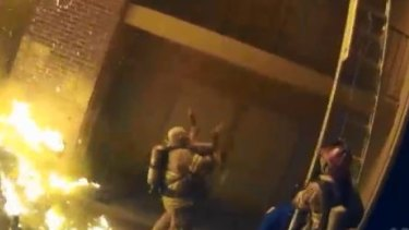 The moment a firefighter in Atlanta catches a child thrown from a burning building.