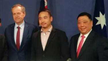 Opposition Leader Bill Shorten with Simon Zhou (centre), who is now campaigning to become mayor of Ryde in Sydney, and NSW Labor MP Ernest Wong at a 2016 election press conference.