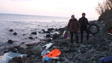 Richard Flanagan and Ben Quilty on Lesbos, surveying the physical remnants - including a life jacket - of the refugee crisis.