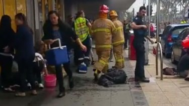 People carried buckets and Eskies full of water to help the victims of the Springvale bank fire.