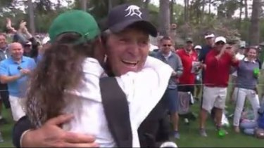 Loving life: Gary Player hugs his grandaughter Alex after the ace.