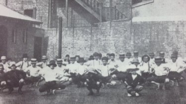 Boys exercising in the yard of the Metropolitan Boys' Shelter, part of the Albion Street Children's Court, in 1913.