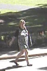 Security footage of the woman suspected of setting alight a flag at the Hyde Park war memorial.