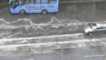 A foam residue on the streets of Tianjin after recent rains is causing public concern.