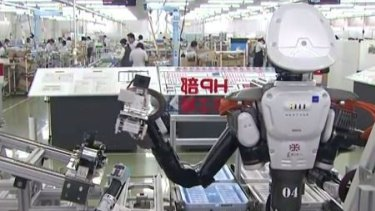 Robots in the workplace at Glory Ltd in Japan.