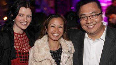 Amber Harrison (left), with her boss Nick Chan and his wife Peggy. Chan was responsible for approving Harrison's $500,000 in expenses over five years.
