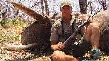 Glenn McGrath posing with a dead elephant.