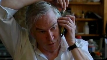 Uncertainty and complexity: Michael Lawler demonstrates his unorthodox and possibly illegal phone recording technique.