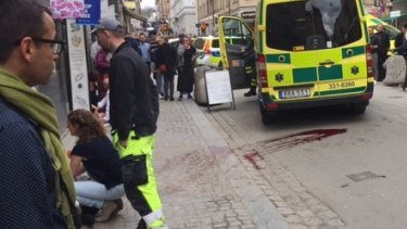 Emergency services tend to the injured in central Stockholm.