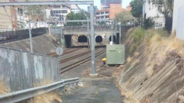 Torrential rain simply runs down hard-paved areas to Fortitude Valley train station six metres lower than ground level