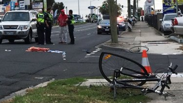 Police at the scene after a cyclist was hit on Sydney Road, Coburg.