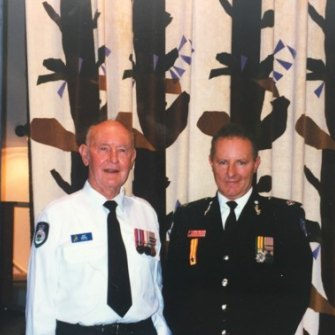 Greg Mullins, former Fire and Rescue NSW commissioner, with his father Jack (left).